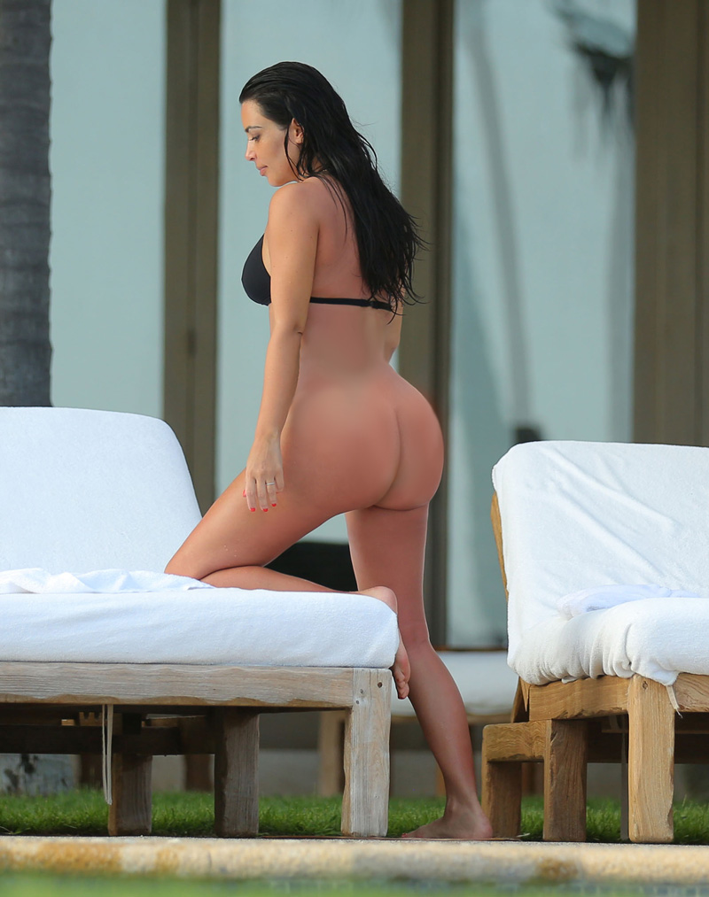EXCLUSIVE: ** PREMIUM RATES APPLY ** NO WEB USAGE ** Kim Kardashian relaxing by the pool while enjoying a second honeymoon in Mexico with Kanye West.